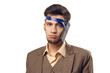 A humorous photo of modern technologies. Young guy with a phone attached to the head using a tape