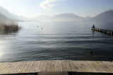 Man sitting on pontoon lake annecy