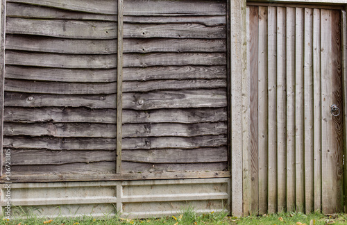 Poster Wooden fence with gate on private propert land seperated from wa