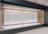 Blank mock up of store street showcase window in a city. 3D rend