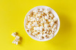 Popcorn in a bowl on a yellow background