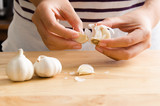 Woman peeling garlic by hand for cooking - 136746081