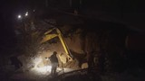 excavator digs a pit night