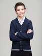 Happy pretty teenage boy posing at studio