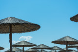 Abstract and conceptual summer, thatched umbrellas or wicker.