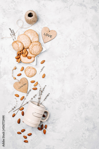 Border with cookies, mug, almonds, lavender and decoration.  Background with Free Space for your  Text, Top View.