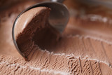 scooping chocolate ice cream close up shot, shallow focus - 136776280