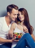 Couple eating salad together