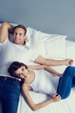 young attractive happy couple on the bed