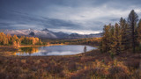 Mirror Surface Lake Autumn Landscape With Mountain Range On Background