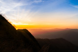 Sunset in the silhouette mountains , beautiful landscape with sunrays