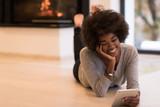 black women used tablet computer on the floor