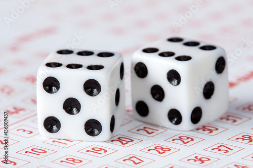Plakat Close-up of dices on lottery ticket