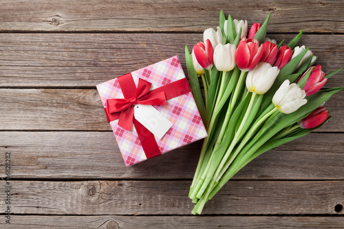 Colorful tulips and gift box