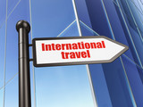 Vacation concept: sign International Travel on Building background