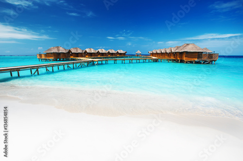 Water bungalows resort at islands. Indian Ocean, Maldives Poster