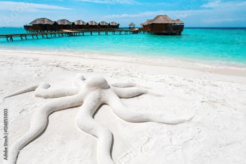 Concept octopus, sand sculpture at tropical beach island resort Poster