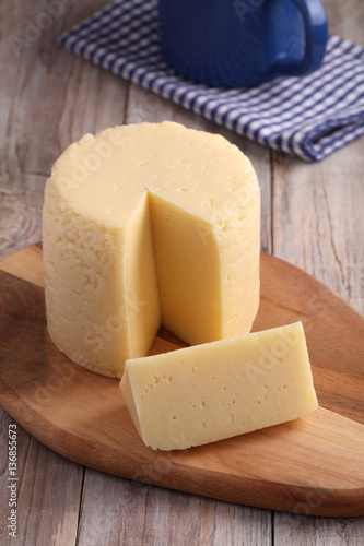 Poster Cheese on a cutting board