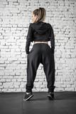 Athletic girl posing in gym