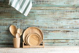 Kitchen cooking utensils in storage on the wood background