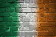 painted national flag of ireland on a brick wall - 136884250