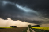 dangerous storm clouds over the country road