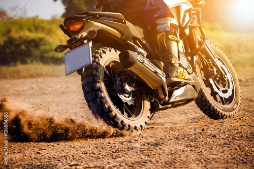Poster man extreme riding touring enduro motorcycle on dirt field