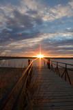 sunrise sunburst over a fishing dock