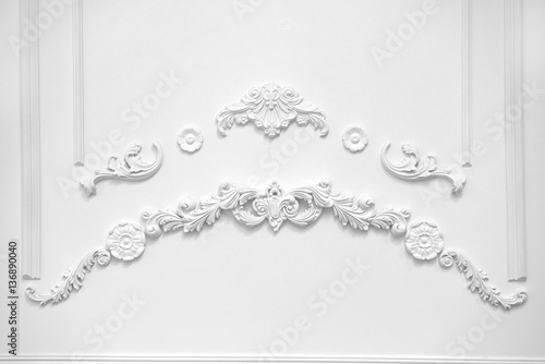 Stucco elements on white wall - 136890040