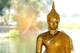 Face of Golden Buddha statue close up, sunlight background, thai