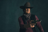 Vintage late 1960s spaghetti western actor. Shooting with revolv - 136896455
