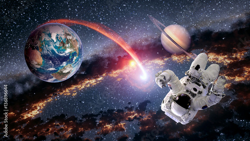 Foto op Canvas UFO Astronaut planet Earth Saturn spaceman launch outer space galaxy universe. Elements of this image furnished by NASA.