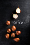 Image of onion over dark chalkboard background