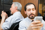 Business people using their mobile phone in the office