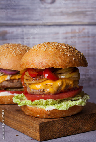Beef burgers with red, yellow peppers, napa cabbage and cheddar Poster