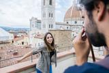 Couple in love taking photo in front Santa Maria del Fiore