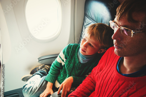 father and little son travel by plane