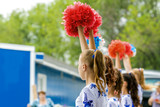 group of young girls cheerleader with red pom-poms - 136958020