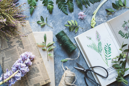 Floral background with books and rope coils