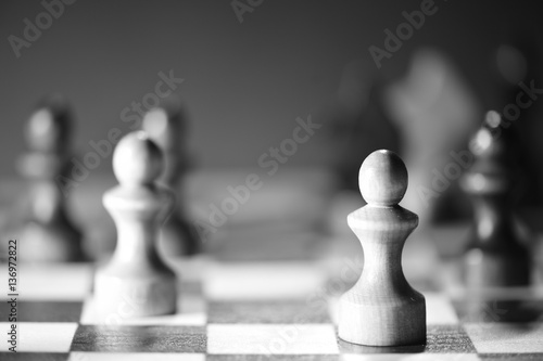 Juliste Chess on a chess board in black and white