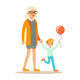 Grandmother And Boy With Balloon Holding Hands Walking, Part Of Grandparents Having Fun With Grandchildren Series