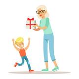 Grandmother Giving Present To Boy, Part Of Grandparents Having Fun With Grandchildren Series