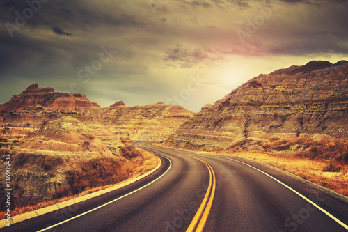 Papiers peints Cappuccino Scenic road at sunset, color toned picture, Badlands National Park, South Dakota, USA.