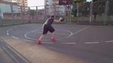 Rear back view man plays basketball urban view. Active lifestyle summer season.