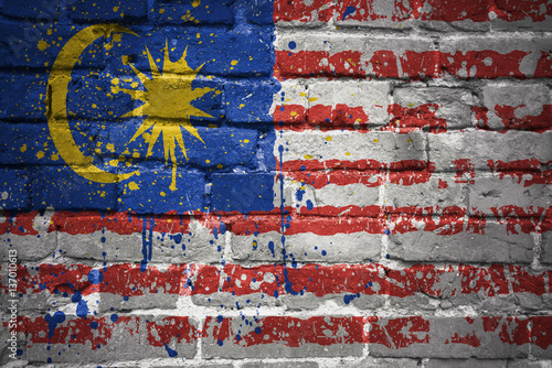 Poster painted national flag of malaysia on a brick wall