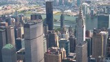 AERIAL: Flying past NYC skyscrapers, East River and Long island in background - 137014642