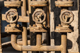 Three rusted valves and pipes
