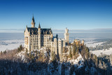 Fototapety Neuschwanstein castle at foggy morning, Bavaria, Germany.