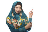 Female wearing a hijab, conservative fashion for muslims, middle east and eastern european culture.  She is isolated on a white background and advertising something.