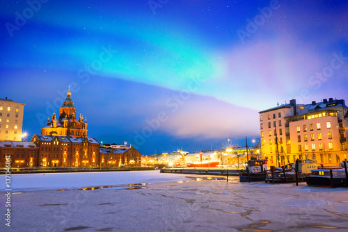 Northern lights over the frozen Old Port in Katajanokka district with Uspenski Orthodox Cathedral in Helsinki, Finland